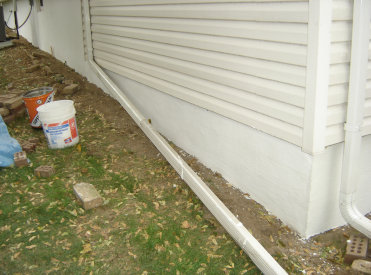 Wooden garage door being scraped of old paint and repainted in Bloomfield, Wayne, Clifton, Paterson, Linden, Elizabeth NJ.